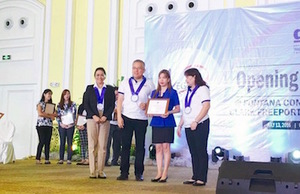 Sheryl Tecuico receives the Award from DTI officials